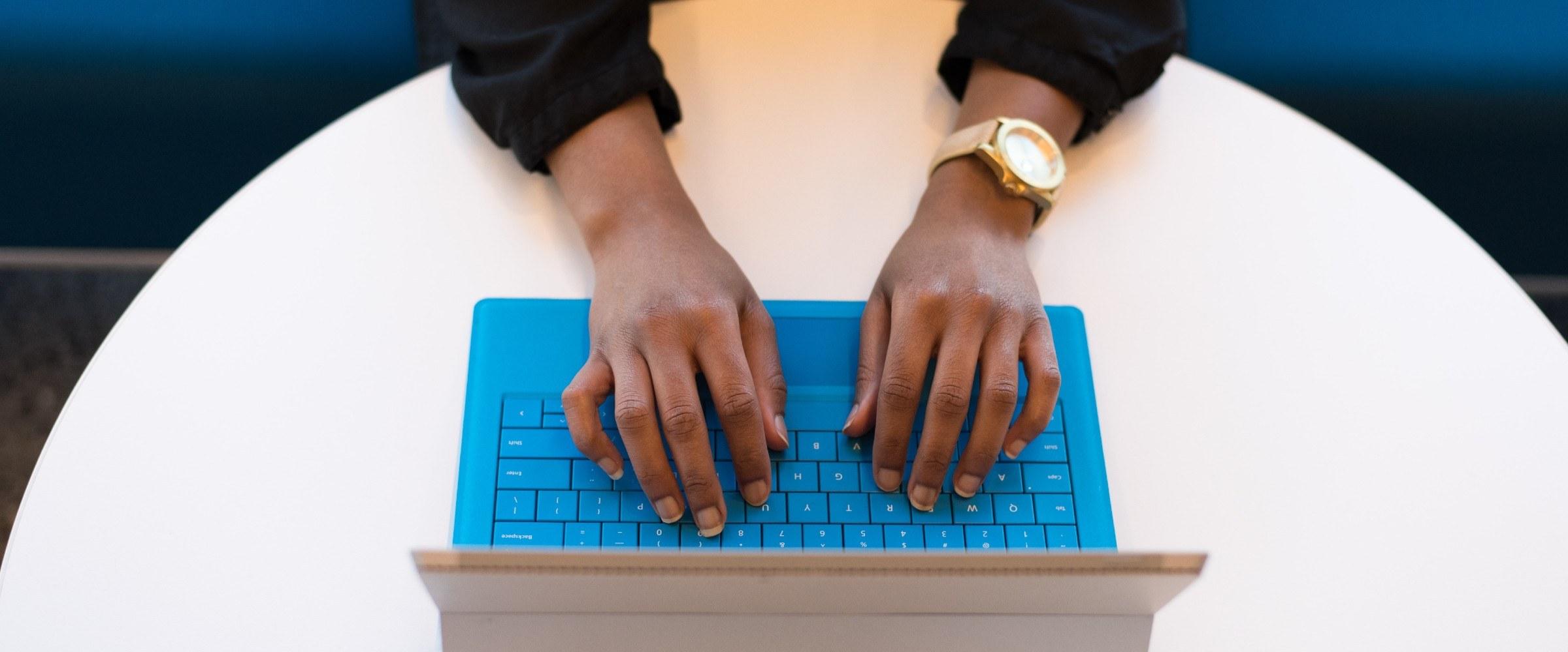 hands typing a real estate listing
